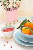 Ripe clementines and red skin pinuts — Stock Photo