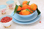 Ripe clementines and red skin pinuts — Foto de Stock