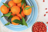 Ripe clementines and red skin pinuts — Photo