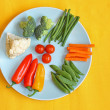 Stock Photo: Bright, fresh vegetables on the blue plate