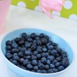 Lovely pink tulips and blueberries — Stock Photo