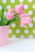 Beautiful tulips in a pink vase — Stock Photo