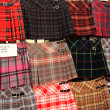 Scottish kilts on display outside the shop - Stock Photo
