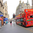 A double decker, tourists bus in the old town of Edinburgh — Stock Photo #22952448