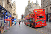 A double decker, tourists bus in the old town of Edinburgh — Stock Photo