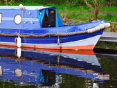 Blue canal boat — Stock Photo