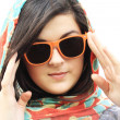 Pretty young woman and sunglasses — Stock Photo