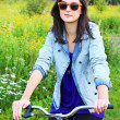 Beautiful young woman and a bike  — Stock fotografie