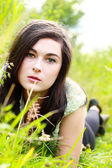 Beautiful young woman in the fields — Stock Photo