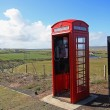 Royalty-Free Stock Photo: Old British red phonebox in the fields