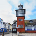 Portrush city hall and tower clock — Stock Photo