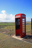 Old British red phonebox in the fields — Stock Photo