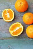 Fresh oranges on the rustic table — Stock Photo