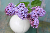 Lovely lilac in the vintage vase — Stock Photo