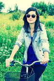 Beautiful young woman and a bike — Stock Photo