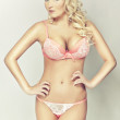 Attractive blond girl in pink lingerie — Stock Photo