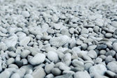 Naturally polished white rock pebbles background — Stock Photo