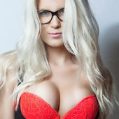 Blonde girl in red bra — Stock Photo