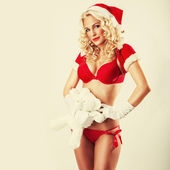 Beautiful and sexy woman dresses as a sexy santa claus — Stock Photo