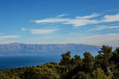 Sea panorama with blue mountains — Stock Photo