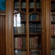 Old books in a old library — Stock Photo