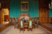 Interior chateau in europe, wood wall, old furniture — Stock Photo