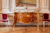 Luxury interior chateau in europe, commode and chair — Stock Photo