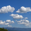 Stock Photo: Sky, clouds and mountain