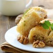 Traditional Turkish arabic dessert - baklava with honey and nuts — Stock Photo #12109455
