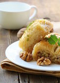Traditional Turkish arabic dessert - baklava with honey and nuts — Stock Photo