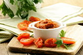 Red pesto sun-dried tomatoes in a white bowl — Stock Photo