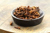 Dried spice cloves on a wooden table — Stock Photo