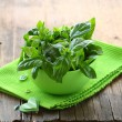 Fresh green basil on a wooden table — Stock Photo #12266425