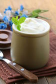 Dairy product (sour cream, yogurt,) in ceramic jar — Stock Photo