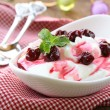 Dairy dessert with sweet  sauce and cherries — Stok fotoğraf