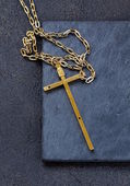 Gold cross on a black background - a religion symbol — Stock Photo