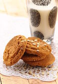 Oat cookies biscuits and a glass of milk — Stock Photo