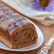 Dessert chocolate biscuit roll on a plate — Stock Photo