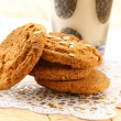 Oat cookies biscuits and a glass of milk — Stock Photo #12763107