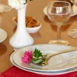 Holiday table setting with flowers — Stock Photo