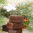 Royalty-Free Stock Photo: Chocolates for Christmas and green Christmas tree