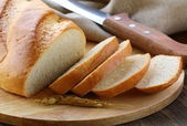 Fresh white loaf of bread , rustic style — Stock Photo
