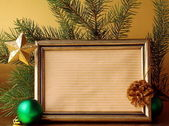 Gold frame and Christmas decorations (Christmas tree and balls) — Stock Photo