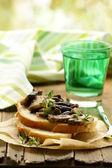 Sandwich crostini with fried mushrooms and thyme — Stock Photo