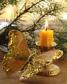 Christmas decoration - fir branches, candles and gold butterfly — Zdjęcie stockowe