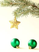 Christmas tree with decorations on white background — Stock Photo
