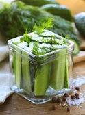 Cucumbers in the jar with dill salt and pepper — Stock Photo