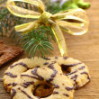Christmas cookies with decorations and fir branches — Stock Photo