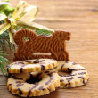 Stock Photo: Christmas cookies with decorations and fir branches