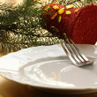 Elegant gold place setting for Christmas - Stock Photo